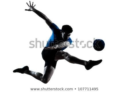 acrobático · futbolista · pelota · posición · cielo - foto stock © RazvanPhotography