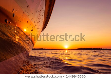 boat side view of blue ocean with sailboat stock photo © lunamarina