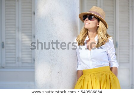 Foto stock: Smiling Woman Wearing Sunglasses And A Straw Hat