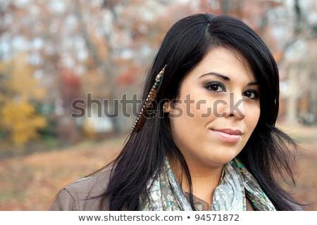 Hispanic woman portrait with feathers Stock photo © rmellinger