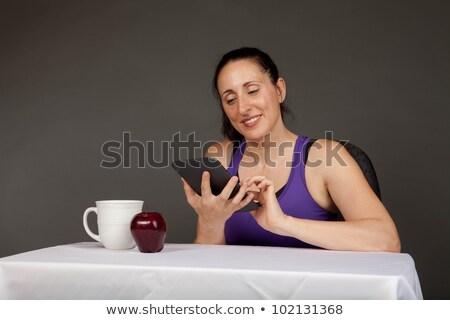 beautiful woman with latte macchiato reading ebook Stock photo © Rob_Stark