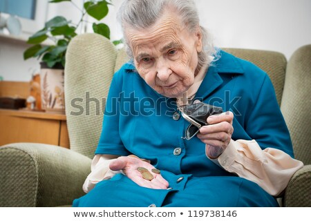 woman looking into her coin purse for money stock photo © photography33