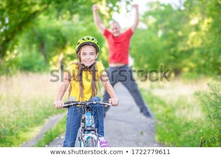 Kız bisiklet kask bilgisayar plaj yaz Stok fotoğraf © photography33