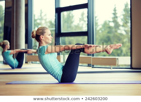 Woman working abdominals Stock photo © photography33