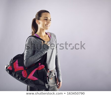 Attractive brunette carrying gym bag Stock photo © photography33