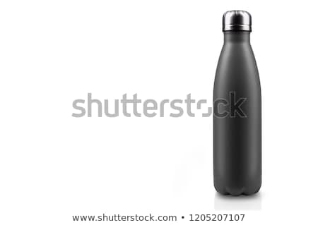 The black matte bottle is isolated on a white background Stock photo © shutswis