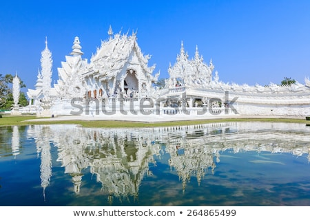 Reflection of White temple Stock photo © timbrk