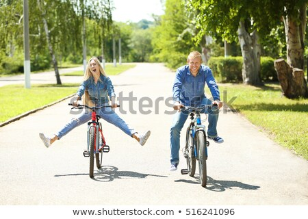 couple riding bikes and relaxing in the park stock photo © photography33