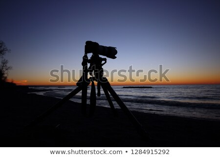 digital slr camera on tripod on beach in summer Stock photo © juniart