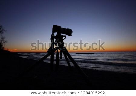 digital slr camera on tripod on beach in summer Stock photo © juniart