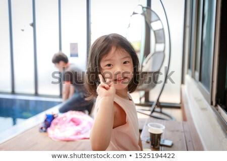 Portrait of a happy family beside the swimming pool Stock photo © wavebreak_media