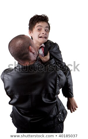 Young boy being aggressively held up by his father  Stock photo © dacasdo