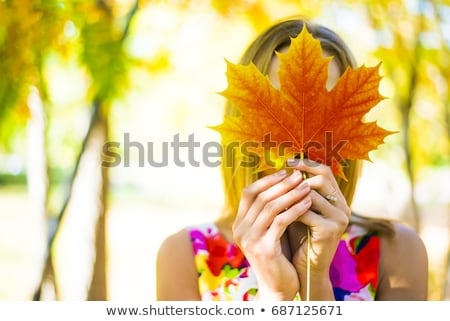 Fall girl holding red Autumn leave outside Stock photo © Maridav