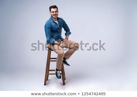 случайный · молодым · человеком · портрет · сидеть · серый · Гранж - Сток-фото © lunamarina