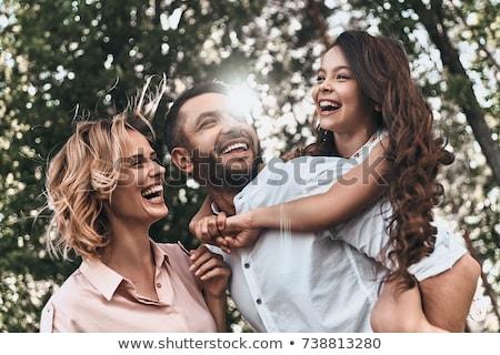 vriendin · op · de · rug · gelukkig · paar · achtergrond - stockfoto © stockyimages