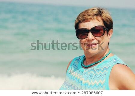 Senior vrouw ademhaling denken ontspannen vrouwelijke Stockfoto © Studiotrebuchet