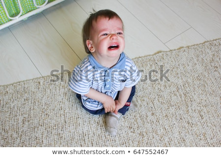 A baby boy crying on a floor Stock photo © vladacanon