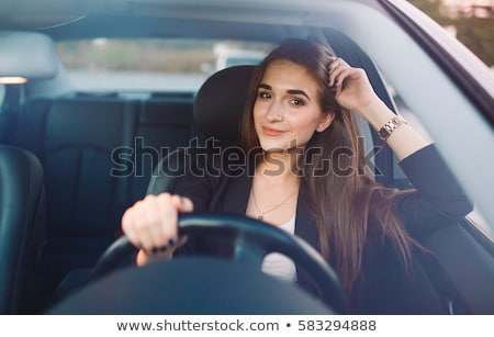Photo stock: Young Smiling Woman Sitting In Car Taking Key