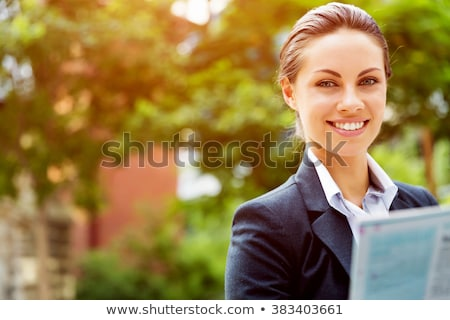attractive young successful smiling business woman standing outdoor stock photo © juniart