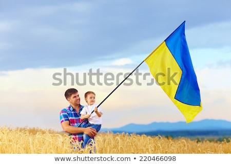 Ukraine flag. Man holding banner with Ukrainian Flag. Stock photo © stevanovicigor