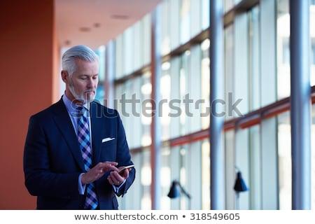 Sakal iş adamı konuşma cep telefonu iş adam Stok fotoğraf © sebastiangauert