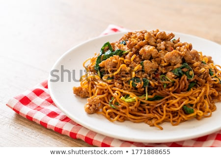 delicious asian spicy fried noodles stock photo © szefei