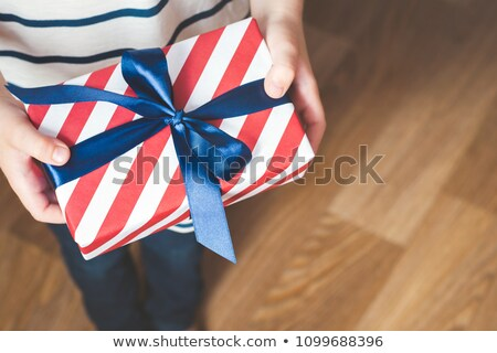 Overhead View Of Children Giving Father Gift Stock photo © monkey_business