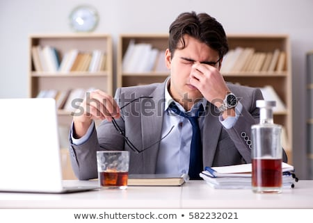 Stock photo: Tired business man with a glass of cognac