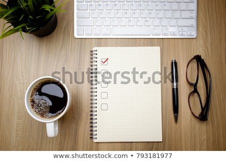 Laptop with checkbox, books and coffee Stock photo © jossdiim