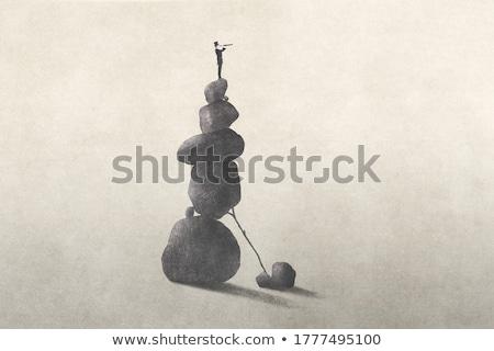 Inestable mano uno pirámide pequeño granito Foto stock © Stocksnapper