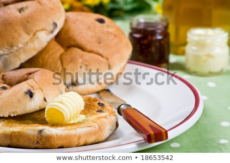 Hot tea cakes with melted butter jam and honey Stock photo © raphotos