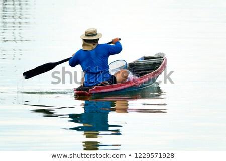 Rybaka ryb mały łodzi stałego duży Zdjęcia stock © HennieV