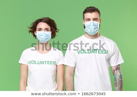 man wearing green shirt sneezing stock photo © ozgur