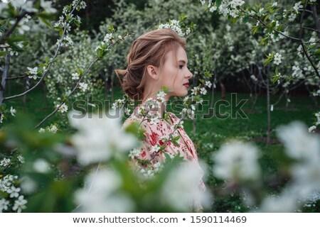 Liebenswert Frauen duftenden Garten Obstgarten Blume Stock foto © konradbak