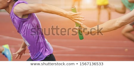 athletic runners passing baton in relay race Stock photo © dotshock
