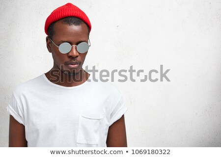 Attactive young fashion man looking down Stock photo © feedough