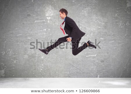 Business man big jump  stock photo © fuzzbones0