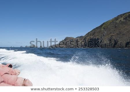 парусного лодка удаленных крутой утес побережье Сток-фото © roboriginal