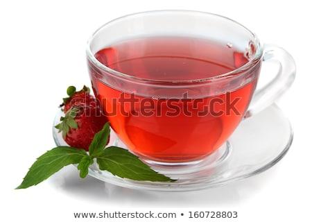 стекла Кубок чай клубника зеленые листья изолированный Сток-фото © tetkoren