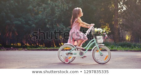 Pretty young girl riding bike in a forest. Stock photo © nenetus