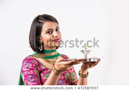 Foto d'archivio: Woman Holding A Puja Thali On Diwali