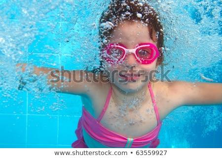 vízalatti · kislány · rózsaszín · bikini · kék · úszómedence - stock fotó © lunamarina