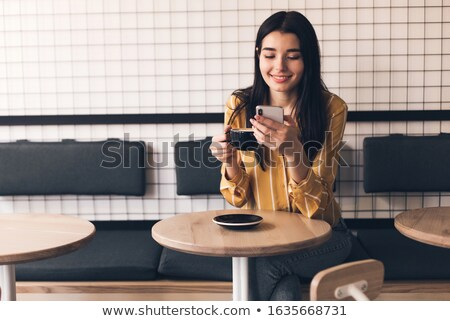 Young pretty woman talking on the phone in a cafe Stock photo © vlad_star
