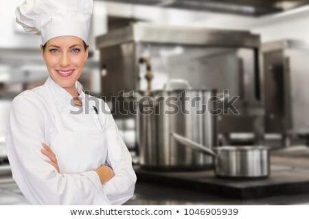 Composite image of pretty chef standing with arms crossed Stock photo © wavebreak_media