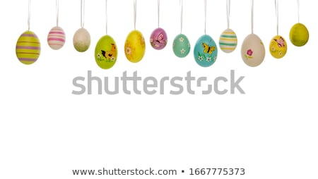 hanging row of hand painted easter eggs Stock photo © Rob_Stark