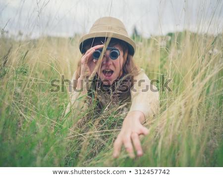 женщину Safari глядя бинокль молодые Сток-фото © kasto