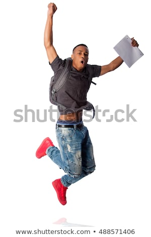 Student jumping because good grades Stock photo © phakimata