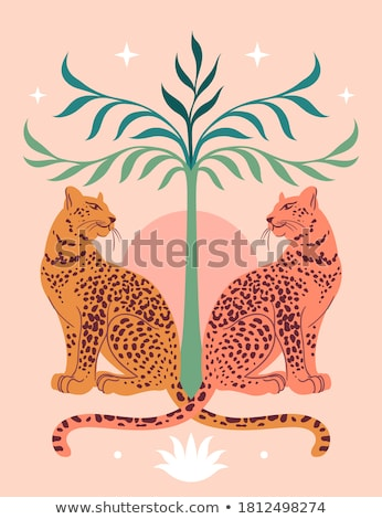 Leopard starring out of a tree. stock photo © simoneeman