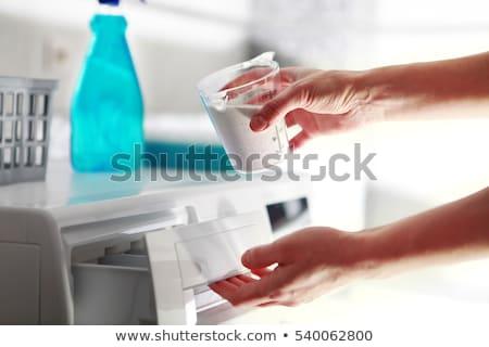 Mãos mulher detergente máquina de lavar roupa máquina limpeza Foto stock © ssuaphoto