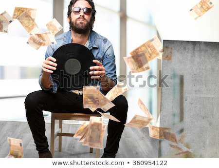 Happy man with vynil Stock photo © deandrobot
